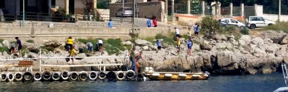 I sub e gli scout ripuliscono i fondali e la scogliera di Isola