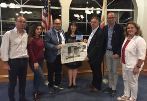 Martinez Vice Mayor Debbie McKillop, center, met with representatives from the Isola delle Femmine delegation from Sicily, as they display a newspaper special section devoted to Martinez native son Joe DiMaggio, whose parents moved to California from Sicily. From left are Marco Mogavero, vice president of the Isola delle Femmine-Pittsburg Committee; Viviana Gradino, a member of the Isola city council; Isola Mayor Stefano Bologna; McKillop; Antonio Scala, president of the Isola-Pittsburg sister city committee; Pietro S. Rappa; and Dr. Anna Maria Lucido Lo Dico. (Courtesy of Debbie McKillop)